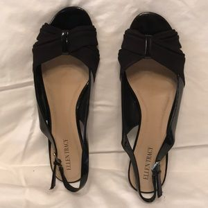 Black open toed sandal with small heel.